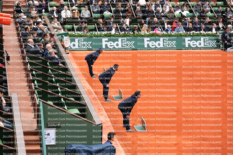 French Open tennis line umpires stand ready to call a ball in play or not