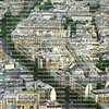 Close up aerial view of Paris rooftops and tree lined streets