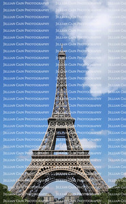 The Eiffel Tower against blue skies and white clouds
