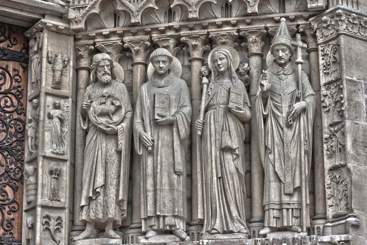 Close up of statues outside Notre Dame Cathedral in Paris, France