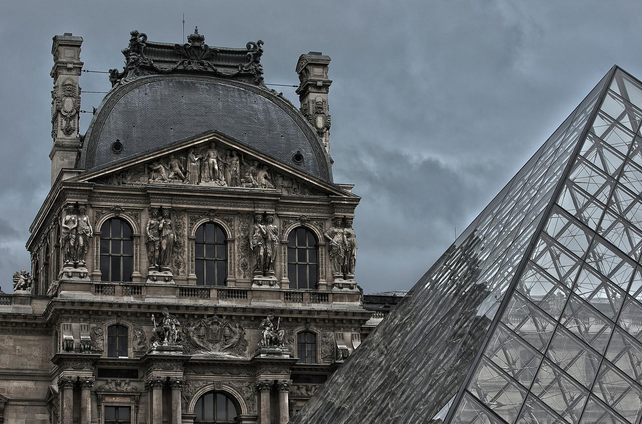 The Louvre Museum and the Glass Pyramid in Paris, France