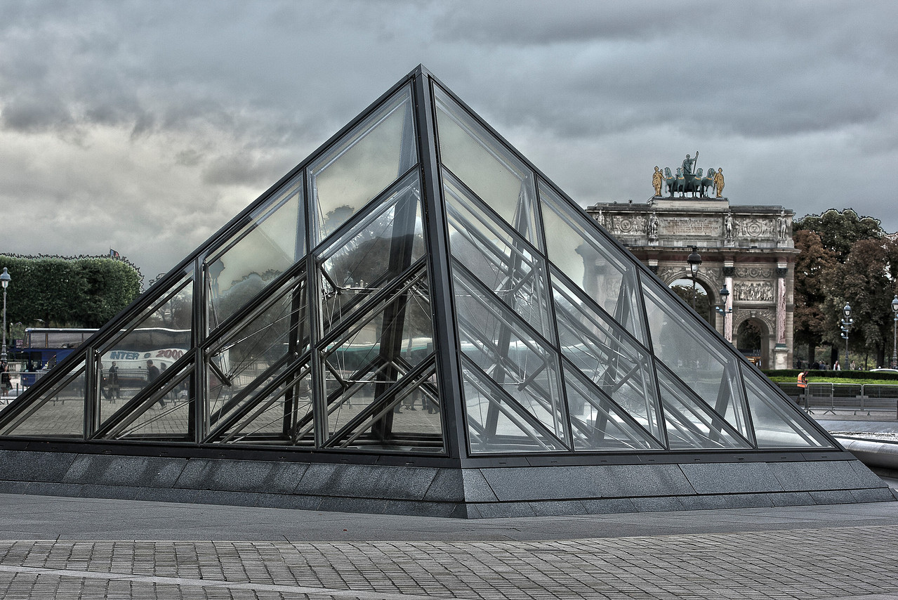 Glass Pyramid at the Louvre Museum in front of the Arc de Triomphe du Carousel Monument in Paris, France
