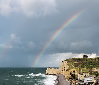 Etretat cliffs and rainbow