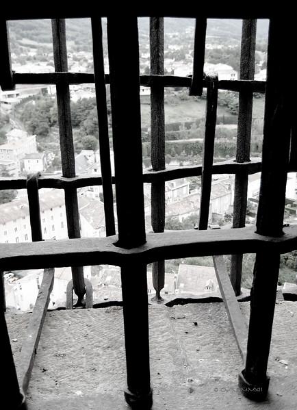 Bared window of a prison cell at Château de Foix, Ariège