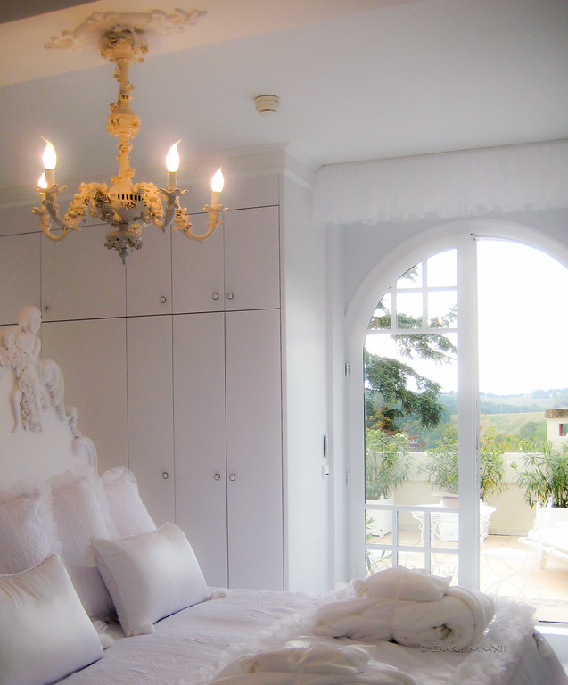 The slightly over-the-top-all-white honeymoon suite at the boutique hotel Château Les Charmettes in Auch, Gers