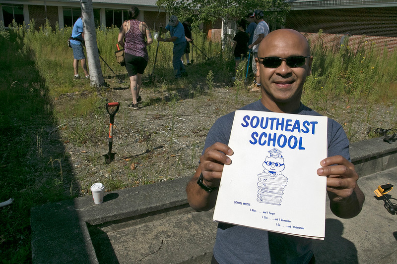 Frances Drake Elementary School. formally the Southeast School, in Leominster was the sight of a search for a time capsule on Saturday. Principal Andres Vwera shows off the late 70's year book that had an entry about the capsule that got them to start looking for it. SENTINEL & ENTERPRISE/JOHN LOVE
