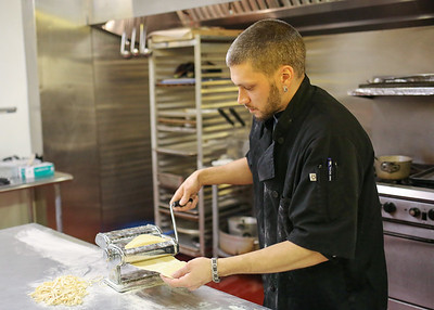 Ryan Seier makes homemade pasta at Francesca's Wine Bar and Bistro.  Photo by John Fitts