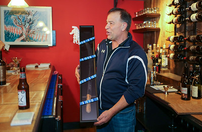 Don Nadeau holds a Collins Co. machete, which was a gift from a customer.  Photo by John Fitts