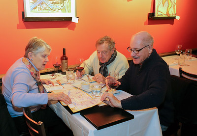 At Francesca's - Marjorie Clarke, Walter Kendra and Don Diodato talk about an upcoming trip to Italy that they and two others will be taking in February. They also plan to visit Bologna, the city in which Francesca's chef and owner Jonathan Nadeau, has worked.  Photo by John Fitts
