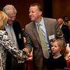Cathy and Doug Olesen, greeting Tim Kerrigan and daughter