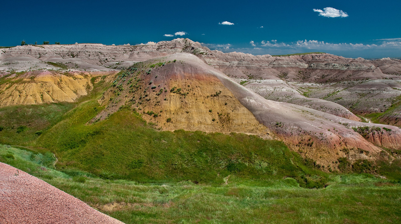 Yellow Mounds Badlands NP.  This area has all the color that is to be seen from the overlooks.  Perhaps if you hike the trails you'll find similar color in the formations elsewhere in the park.