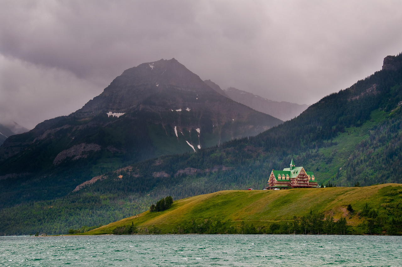 The Prince of Wales Hotel sits atop a lofty hill that jutts out into Waterton Lake about a half a mile North of Waterton Township, in Alberta Canada.  The Canadian side of the NP is very scenic, and the off and on rain showers framed the mountains in a misty light that was accented by rays of brightenss as the clouds moved quickly in a strong wind.