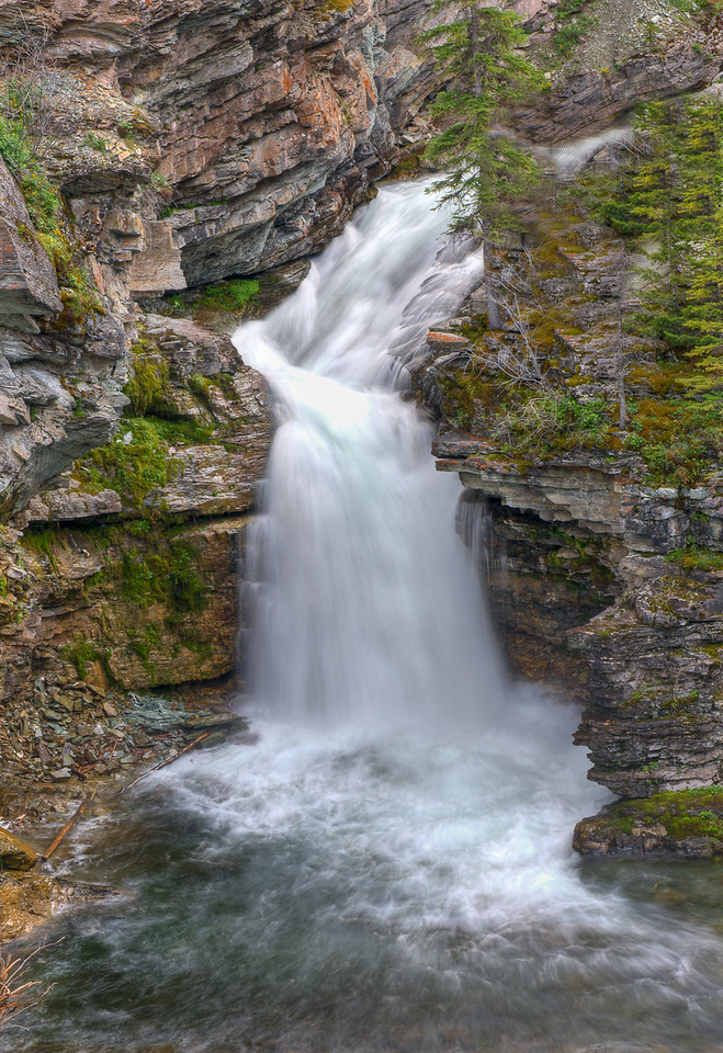 Blakiston Falls is at the end of a trail that leads out of Red Rock Canyon in Waterton NP on the Canadian side of the NP.  This image is an HDRI processed in Photomatix.