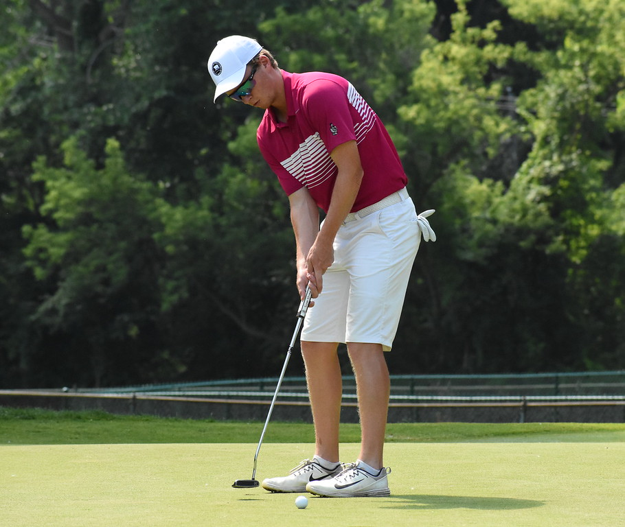 . The 50th annual Frank Syron Memorial Tournament kicked off Friday at the Pontiac Country Club in Waterford Township. More than 130 golfers teed off in the extreme weather conditions. (The Oakland Press photo by Jason Schmitt)