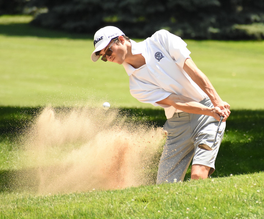 . Josh Line, from Bloomfield Hills, hits a shot out of the bunker on the No. 4 green Friday at the 50th annual Frank Syron Memorial Tournament at the Pontiac Country Club in Waterford Township. More than 130 golfers teed off in the extreme weather conditions. (The Oakland Press photo by Jason Schmitt)