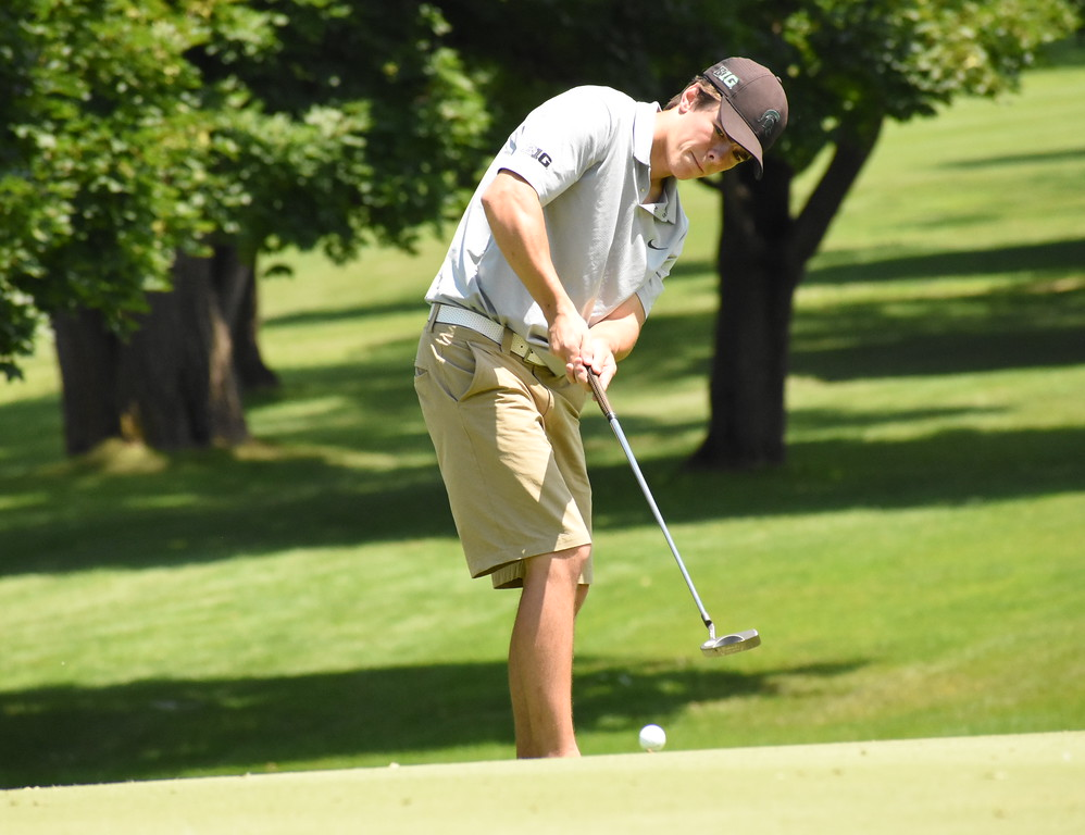 . Canton-native Glenn Piot, Jr. putts on the 12th green Friday at The 50th annual Frank Syron Memorial Tournament kicked off Friday at the Pontiac Country Club. Piot, a former Novi Detroit Catholic Central and current Michigan State University golfer, is competing in his third Syron Tournament. (The Oakland Press photo by Jason Schmitt)