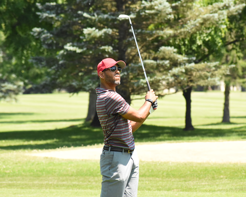 . Pontiac native Brian Yelder watches his approach shot hit the green on the fifth hole Friday during the first round of the 50th annual Frank Syron Tournament at the Pontiac Country Club. (The Oakland Press photo by Jason Schmitt)