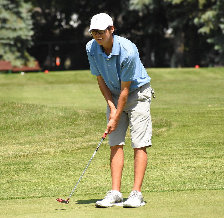 . Auburn Hills Avondale graduate Nikolas Senkowski checks out his line before putting on the eighth green Friday at the 50th annual Frank Syron Memorial Tournament at the Pontiac Country Club in Waterford Township. Senkowski is currently a junior on the Wayne State University men\'s golf team. (The Oakland Press photo by Jason Schmitt)