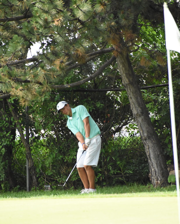 . Canton\'s James Piot chips onto the 17th green Sunday at the Frank Syron Memorial Tournament. Piot finished fourth overall at the tournament after shooting a three day total of 208. (Digital First Media photo by Jason Schmitt)