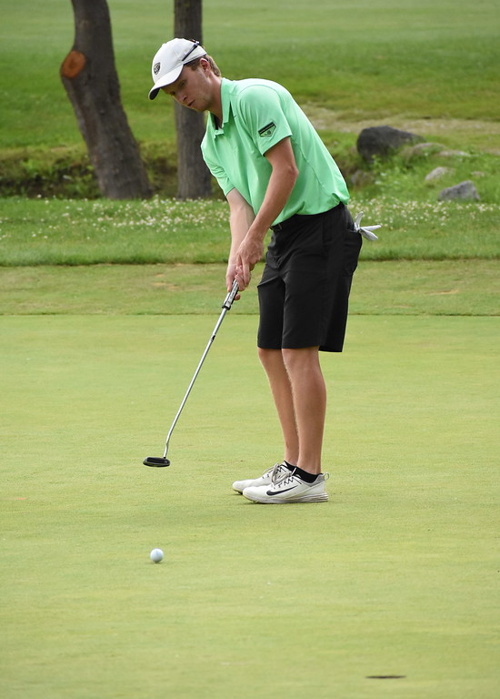 . White Lake\'s Jake Kneen watches his putt approach the 18th hole Sunday during the Frank Syron Memorial Tournament. The eagle putt came up short and Kneed finished runner-up at the tournament. (Digital First Media photo by Jason Schmitt)