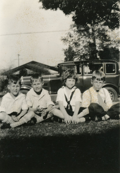 Howard, Frank, and their second cousins Genevieve and Homer James.