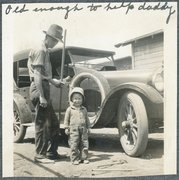 Frank at 2 years old, with his father.