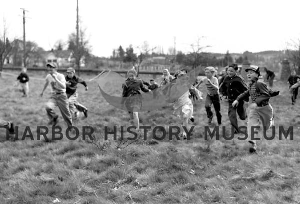 Kids running at Easter Egg Hunt at Gig Harbor City Park