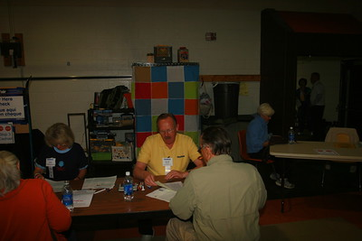 From Left, ulie Richards and Scott Bergers, Lions Volunteers work with our customers at the Cashier station