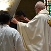 Receiving his cross of perpetual profession