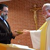 Frater Juancho receives the Bible