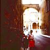 1967  Shirley, Craig, Chistine and Fred Antrobus in a narrow street off the Piaza Dei Signori in Verona.