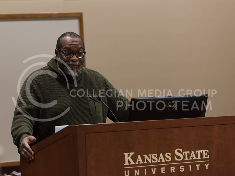 As he smiles to the audience Professor of Performance Studies at New York University Fred Moten continues his lecture to students and faculty members. On Friday, Moten came to the K-State campus to talk about the way he teaches his classes. (Olivia Bergmeier | Collegian Media Group)