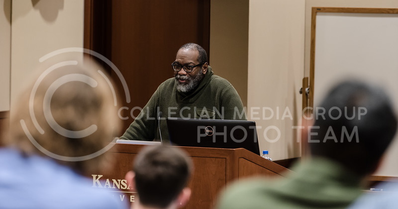 As he stands at the podium, Professor of Performance Studies at New York University Fred Moten speaks to the audience. On Friday, Moten came to the K-State campus to lecture students and faculty about his experiences in the class room. (Olivia Bergmeier | Collegian Media Group)
