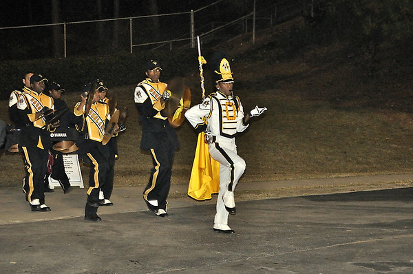 Drum Major Quinterious Brown leads band into Hallford Stadium for the Stephenson game.