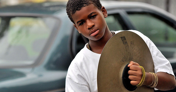 Cymbalist sways to the cadence