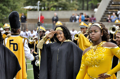 Douglass HS Northstarette Captain Teresa Wilson salutes duing the playing of the National Anthem at Homecoming game Lakewood Stadium