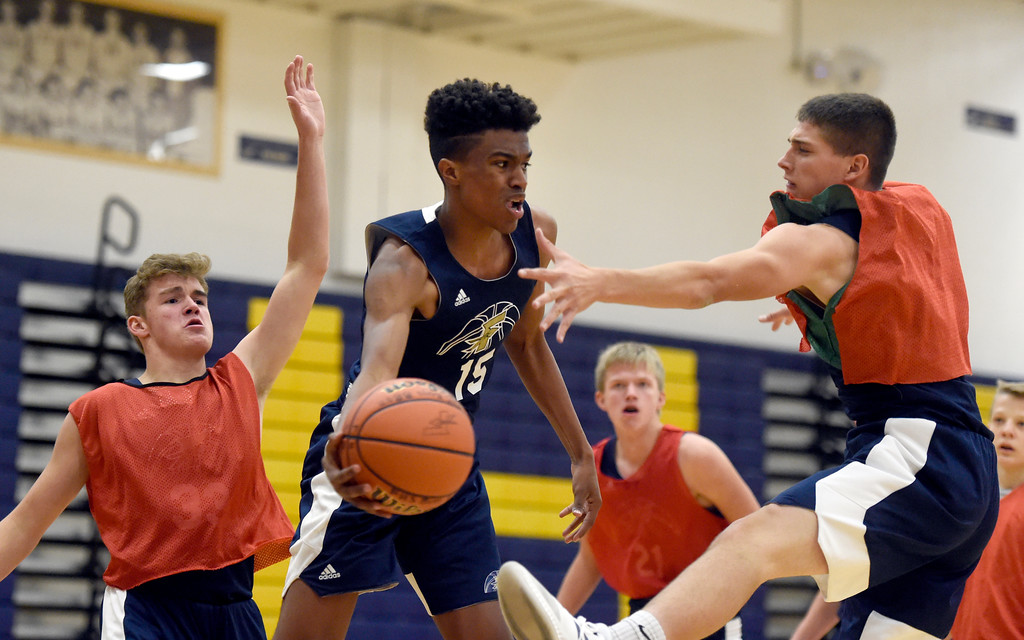 . BOULDER, CO - NOVEMBER 23, 2018: Frederick High School\'s Izayah Elize passes the ball to a teammate during basketball practice on Friday at Frederick High School. More photos: BoCoPreps.com (Photo by Jeremy Papasso/Staff Photographer)