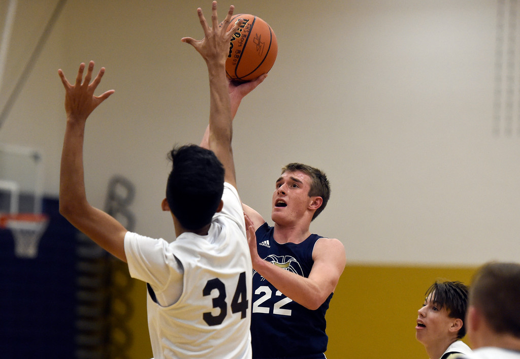 . BOULDER, CO - NOVEMBER 23, 2018: Frederick High School\'s Jake Green takes a shot over a defender during basketball practice on Friday at Frederick High School. More photos: BoCoPreps.com (Photo by Jeremy Papasso/Staff Photographer)