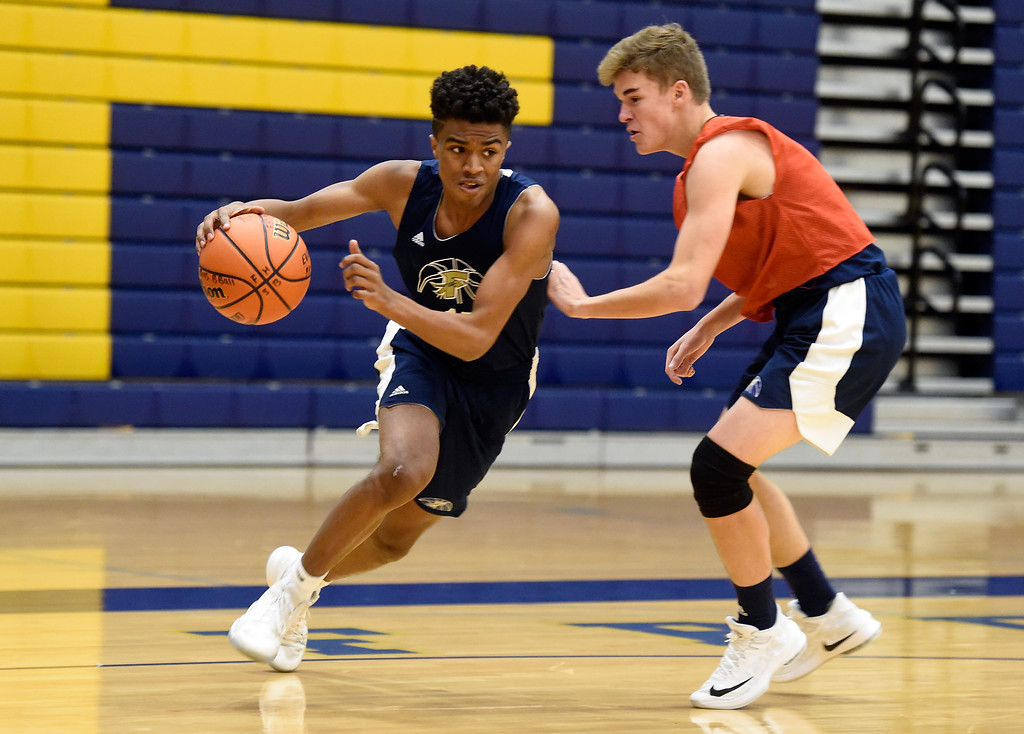 . BOULDER, CO - NOVEMBER 23, 2018: Frederick High School\'s Izayah Elize dribbles past Jacoby Conway during basketball practice on Friday at Frederick High School. More photos: BoCoPreps.com (Photo by Jeremy Papasso/Staff Photographer)