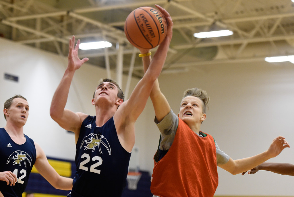 . BOULDER, CO - NOVEMBER 23, 2018: Frederick High School\'s Jake Green snags a rebound over Bryce Conober during basketball practice on Friday at Frederick High School. More photos: BoCoPreps.com (Photo by Jeremy Papasso/Staff Photographer)
