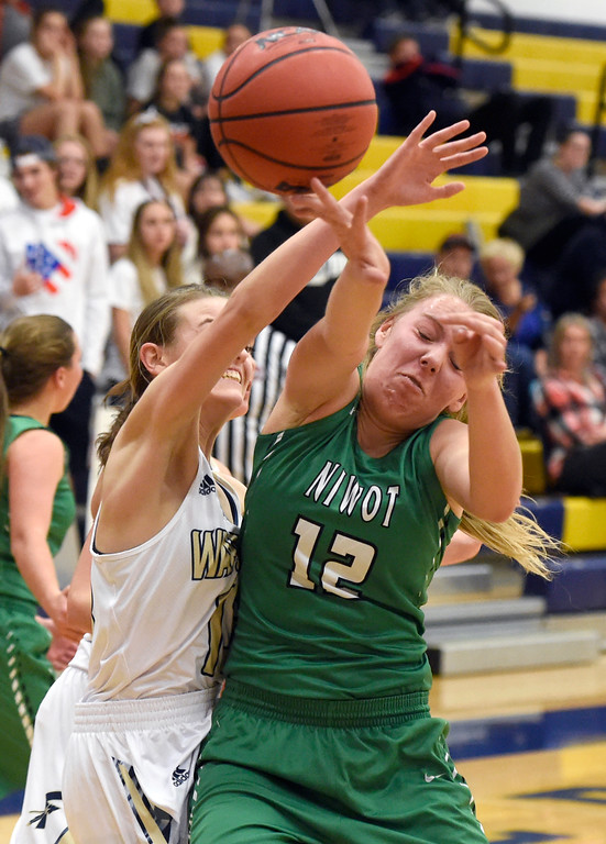 . Niwot High School\'s Rosie Setter fights for a loose ball with Danielle Hemelstrand during a game against Frederick on Wednesday in Frederick. For more photos of the game go to BoCoPreps.com Jeremy Papasso/ Staff Photographer 11/29/2017