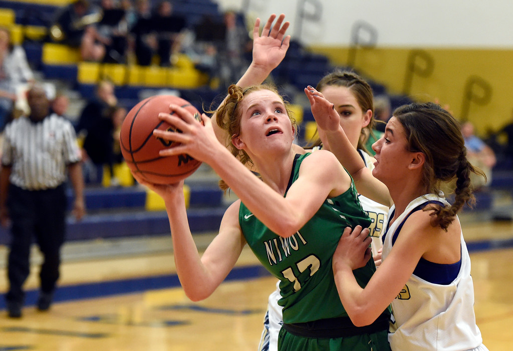 . Niwot High School\'s Mary Gillett drives to the hoop past a swarm of defenders during a game against Frederick on Wednesday in Frederick. For more photos of the game go to BoCoPreps.com Jeremy Papasso/ Staff Photographer 11/29/2017