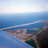 This photo was taken 1974, while I was flying over the coast of Rode Island.<br /> The airport was a closed Air Force Database.
