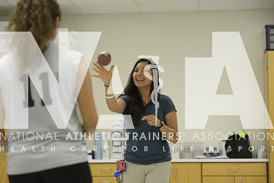 Renee Fernandes/NATA Lorena Y. Escamilla, ATC, LAT, the athletic trainer at  Moises E. Molina High School in Dallas, works on the rehab of a student athlete before a volleyball game at the school.