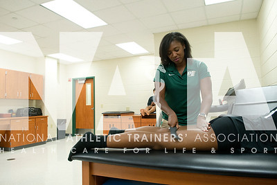 Renee Fernandes/NATA Troi Smith, MS, LAT, ATC, works with the athletes at DeSota High School.