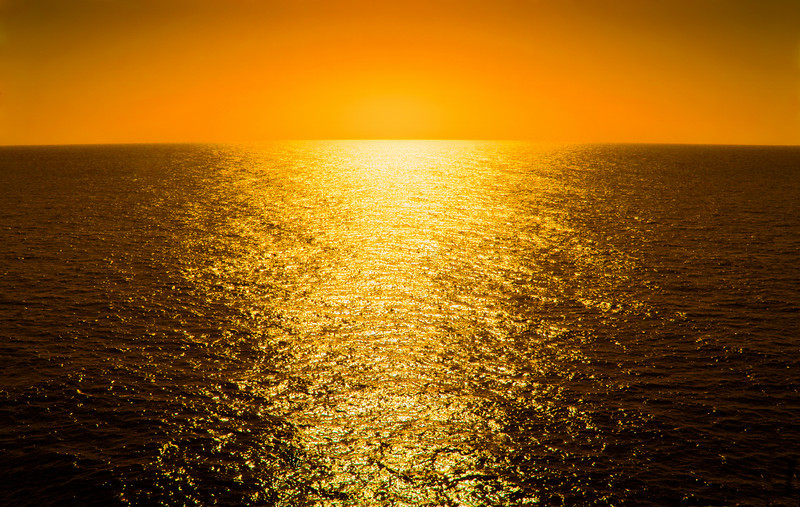 "Sailing Into The Sunset.  A wide-angle, panoramic view of the open sea from the bow of cruise chip, with the warm sun's glare reflecting on ocean.  The ""XLarge"" and smaller photo sizes are FREE for any personal use (under a <a href=""http://creativecommons.org/licenses/by-nc-nd/2.0/"">Creative Commons</a> license). Click the ""Buy"" or shopping cart button (above the image) to purchase prints or downloads. PRICING: 1-megapixel Personal downloads are $4.95; 4-megapixel and ""Original"" (6-megapixel) Personal downloads are $49.95; 1-megapixel Commercial downloads are $49.95, 4-megapixel and ""Original"" (6-megapixel) Commercial downloads are $199.95; NOTE: Free personal use requires a photo credit to my company, ''<a href=""http://www.tssphoto.com/"">The Stock Solution</a>'', and link to that Web site if you use the image on a personal Web site."