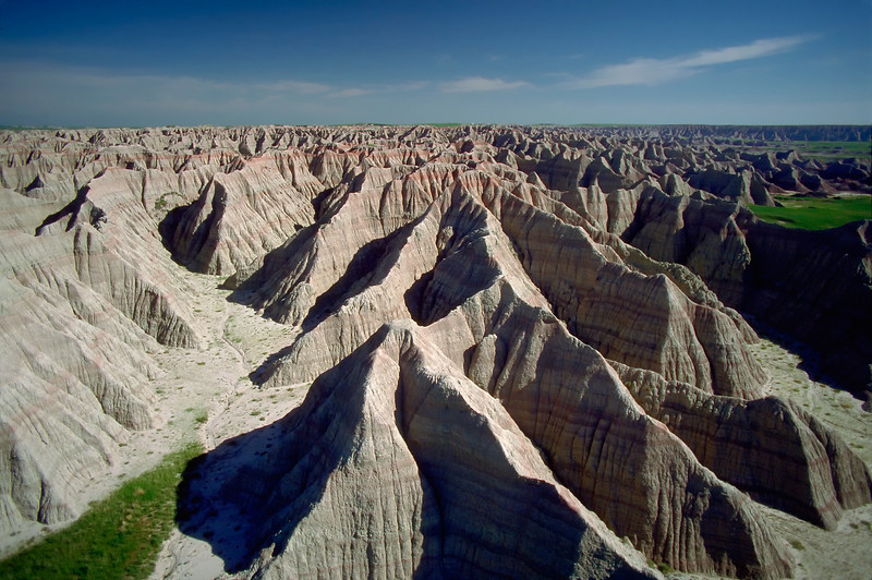 "Erosion In Badlands of South Dakota. A low-altitude helicopter photo of the Badlands National Park in Southwestern South Dakota, showing the unique erosion of this wilderness area.  The ""XLarge"" and smaller photo sizes are FREE for any personal use (under a <a href=""http://creativecommons.org/licenses/by-nc-nd/2.0/"">Creative Commons</a> license). Click the ""Buy"" or shopping cart button (above the image) to purchase prints or downloads. PRICING: 1-megapixel Personal downloads are $4.95; 4-megapixel and ""Original"" (6-megapixel) Personal downloads are $49.95; 1-megapixel Commercial downloads are $49.95, 4-megapixel and ""Original"" (6-megapixel) Commercial downloads are $199.95; NOTE: Free personal use requires a photo credit to my company, ''<a href=""http://www.tssphoto.com/"">The Stock Solution</a>'', and link to that Web site if you use the image on a personal Web site."