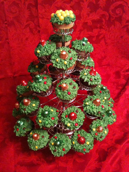 "Christmas tree cupcakes. My two granddaughters decorated these cupcakes and arranged them in this display to look like a Christmas tree. They made these for our extended family Christmas Eve party.   The ""XLarge"" and smaller photo sizes are FREE for any personal use (under a <a href=""http://creativecommons.org/licenses/by-nc-nd/2.0/"">Creative Commons</a> license). Click the ""Buy"" or shopping cart button (above the image) to purchase prints or downloads. PRICING: 1-megapixel Personal downloads are $4.95; 4-megapixel Personal downloads are $49.95; 1-megapixel Commercial downloads are $49.95, 4-megapixel Commercial downloads are $199.95; NOTE: Free personal use requires a photo credit to my company, ''<a href=""http://www.tssphoto.com/"">The Stock Solution</a>'', and link to that Web site if you use the image on a personal Web site."