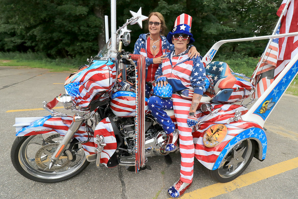 """. The Middlesex GWOT (Global War on Terror) held a funraiser motorcycle \""""Freedom Ride\"""" to raise money for their Global War on Terror Veterans Monument that will be put up near the rotary in Pepperell. They need $200,000 for the monument. They only need $50,000 more to start work on it. At the ride they hoped  to raise $5,000 for the day. The ride was just over 80 miles and ended where it started at the Pepperell VFW. This very patriotic bike, owned by veteran Army SGT. Lance Blais of Groveland MA. was a big hit at the ride. Sitting with him just before the race started is June Hawkins his co-pilot for the ride. SENTINEL & ENTERPRISE/JOHN LOVE"""