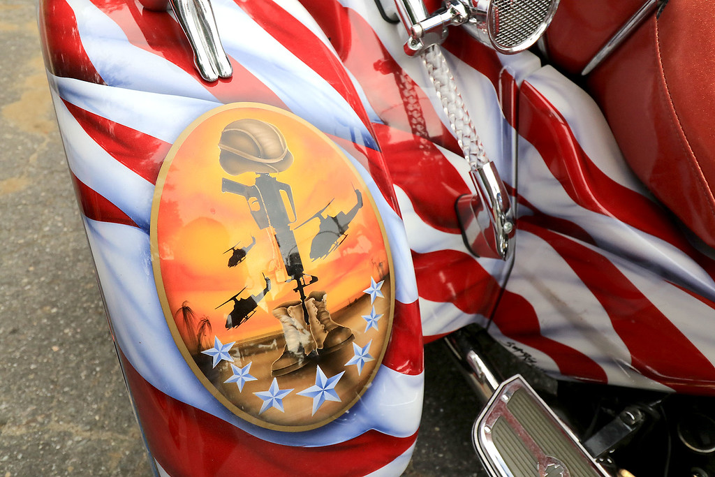 """. The Middlesex GWOT (Global War on Terror) held a funraiser motorcycle \""""Freedom Ride\"""" to raise money for their Global War on Terror Veterans Monument that will be put up near the rotary in Pepperell. They need $200,000 for the monument. They only need $50,000 more to start work on it. At the ride they hoped  to raise $5,000 for the day. The ride was just over 80 miles and ended where it started at the Pepperell VFW. This is a close up of very patriotic bike, owned by veteran Army SGT. Lance Blais of Groveland MA. that was going to be in the ride on Saturday. SENTINEL & ENTERPRISE/JOHN LOVE"""